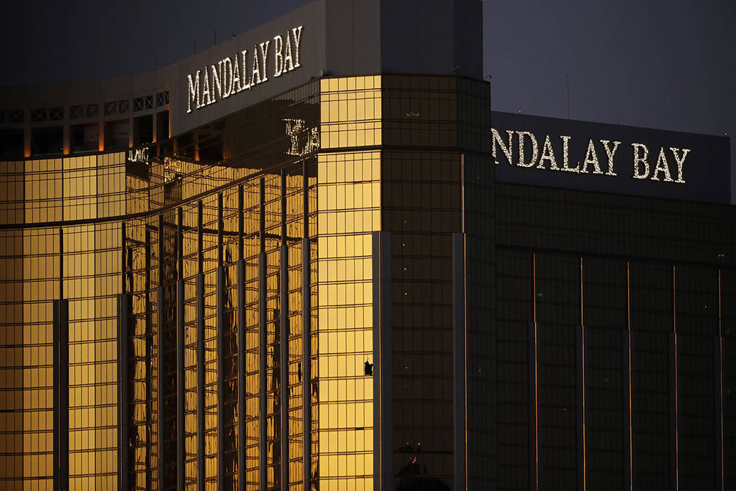 Windows are broken at the Mandalay Bay resort and casino, Tuesday, Oct. 3, 2017, in Las Vegas. Authorities said Stephen Paddock broke the windows and began firing with a cache of weapons, killing  ...
