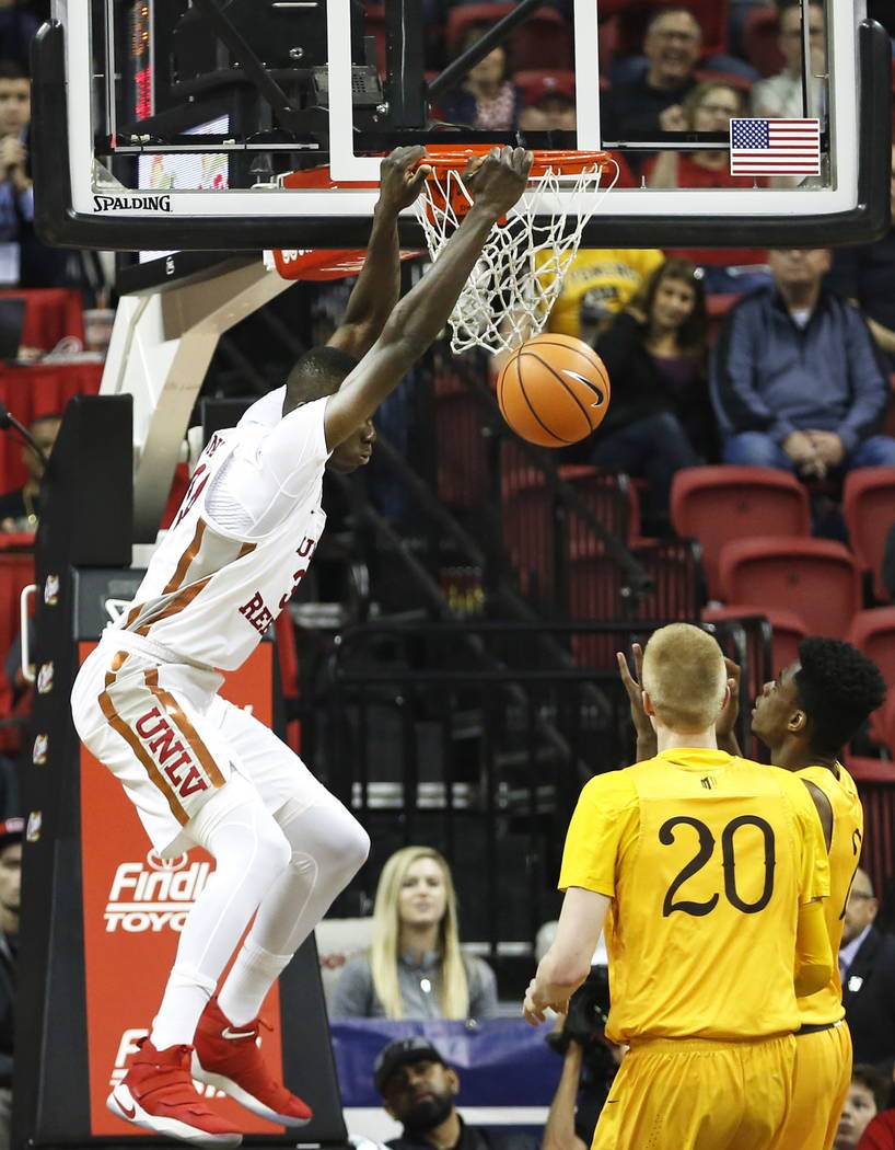 Running Rebels' Cheikh Mbacke Diong (34) dunks the ball during the basketball game against Wyoming at the Thomas and Mack Center in Las Vegas on Saturday, Feb. 10, 2018. Andrea Cornejo Las Vegas R ...