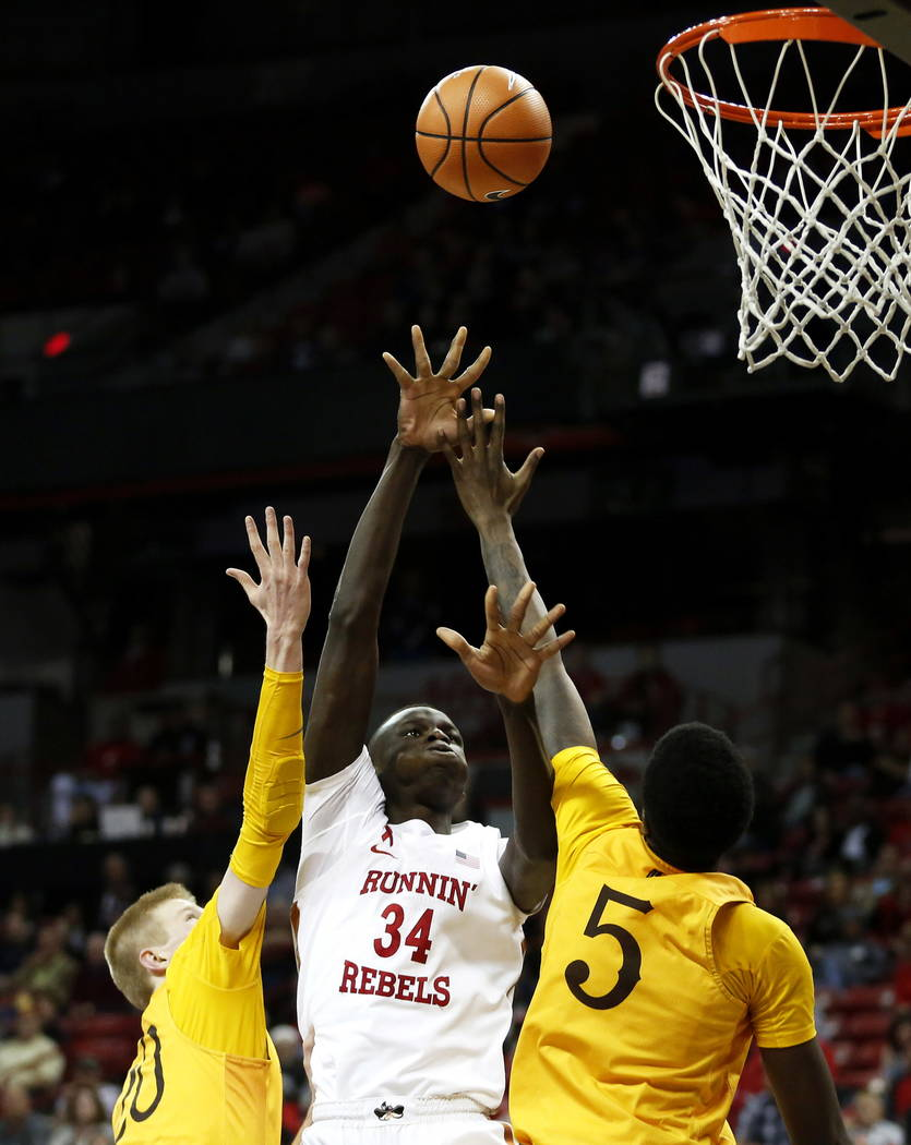 UNLV Rebels' Cheikh Mbacke Diong (34) reaches for the ball during the basketball game against the Wyoming Cowboys at the Thomas and Mack Center in Las Vegas on Saturday, Feb. 10, 2018. Andrea Corn ...