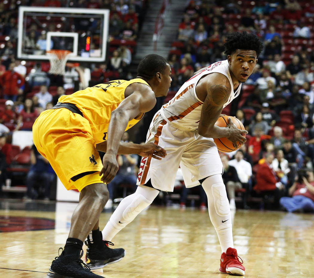 Running Rebels' Jovan Mooring (30) gets ready to pass the ball during the basketball game against the Wyoming Cowboys at the Thomas and Mack Center in Las Vegas on Saturday, Feb. 10, 2018. Andrea  ...