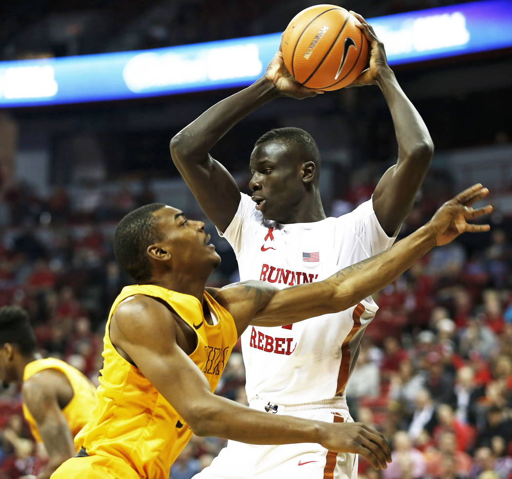 Running Rebels' Cheikh Mbacke Diong (34) passes the ball during the basketball game against the Wyoming Cowboys at the Thomas and Mack Center in Las Vegas on Saturday, Feb. 10, 2018. Andrea Cornej ...
