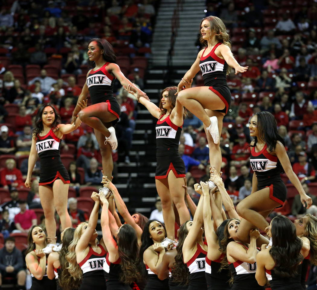 UNLV Rebel Cheerleaders perform during the basketball game against the Wyoming Cowboys at the Thomas and Mack Center in Las Vegas on Saturday, Feb. 10, 2018. Andrea Cornejo Las Vegas Review-Journa ...