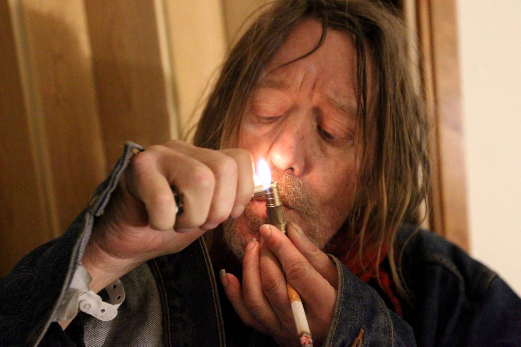 Gary, who declined to give his last name, smokes what he said is marijuana in his room at 724 N. 9th St. in downtown Las Vegas Thursday, Jan. 25, 2018. The home was part of a Nevada state program  ...