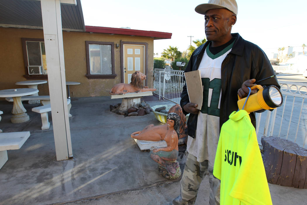 Jeff Woods, who is a security guard at 724 N. 9th St. in downtown Las Vegas, talks to a reporter at the property Friday, Jan. 26, 2018. The home was part of a Nevada state program that pays provid ...