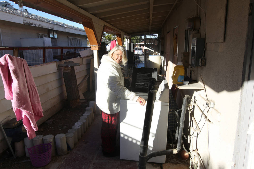 Linda Pellow does laundry at 724 N. 9th St. in downtown Las Vegas Friday, Jan. 26, 2018. The home was part of a Nevada state program that pays providers to house and feed mentally ill clients. K.M ...