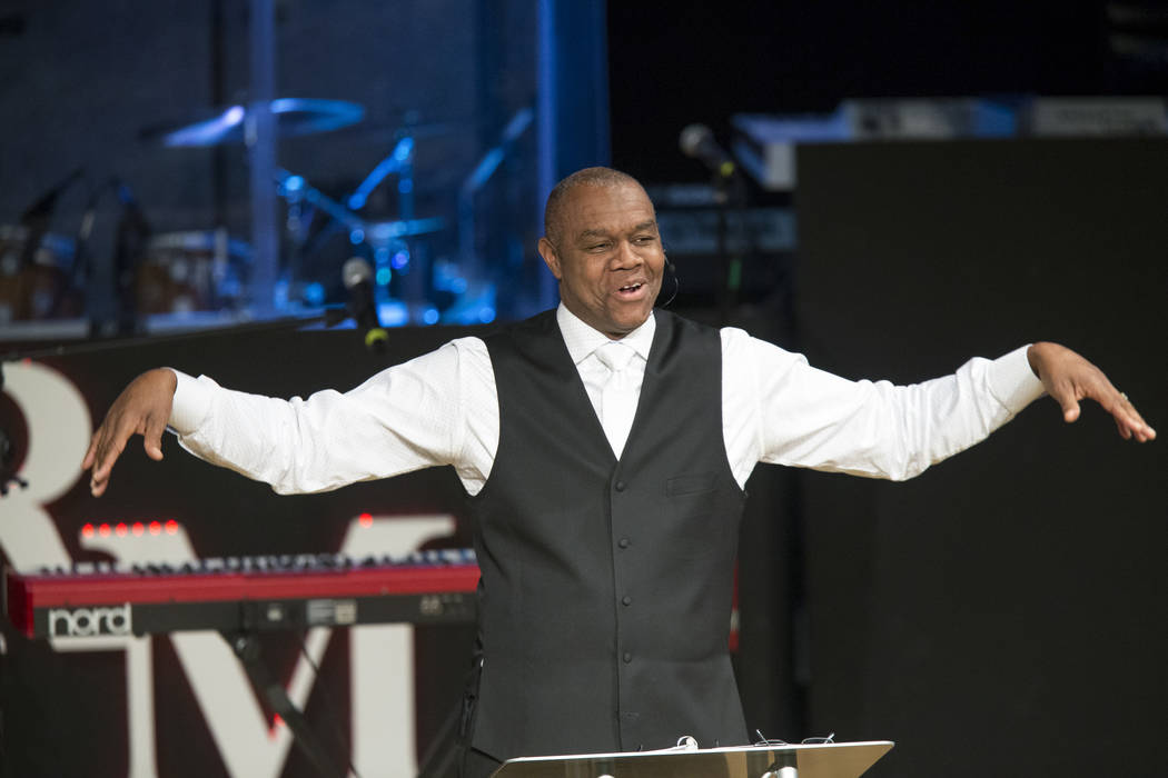 Former Philadelphia Eagles quarterback and Remnant Ministries Pastor Randall Cunningham waves his arms as he pretends to fly as he jokes about his former team going to the Super Bowl before a serm ...