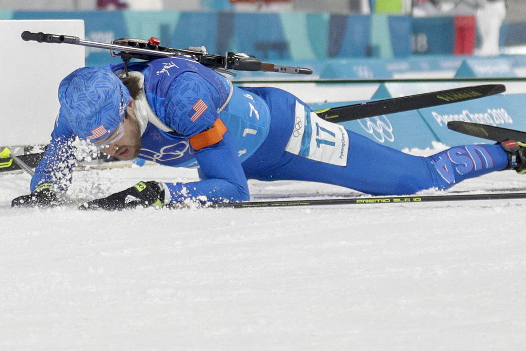 Leif Nordgren, of United States of America, collapses in the finish area after the men's 4x7.5-kilometer biathlon relay at the 2018 Winter Olympics in Pyeongchang, South Korea, Friday, Feb. 23, 20 ...