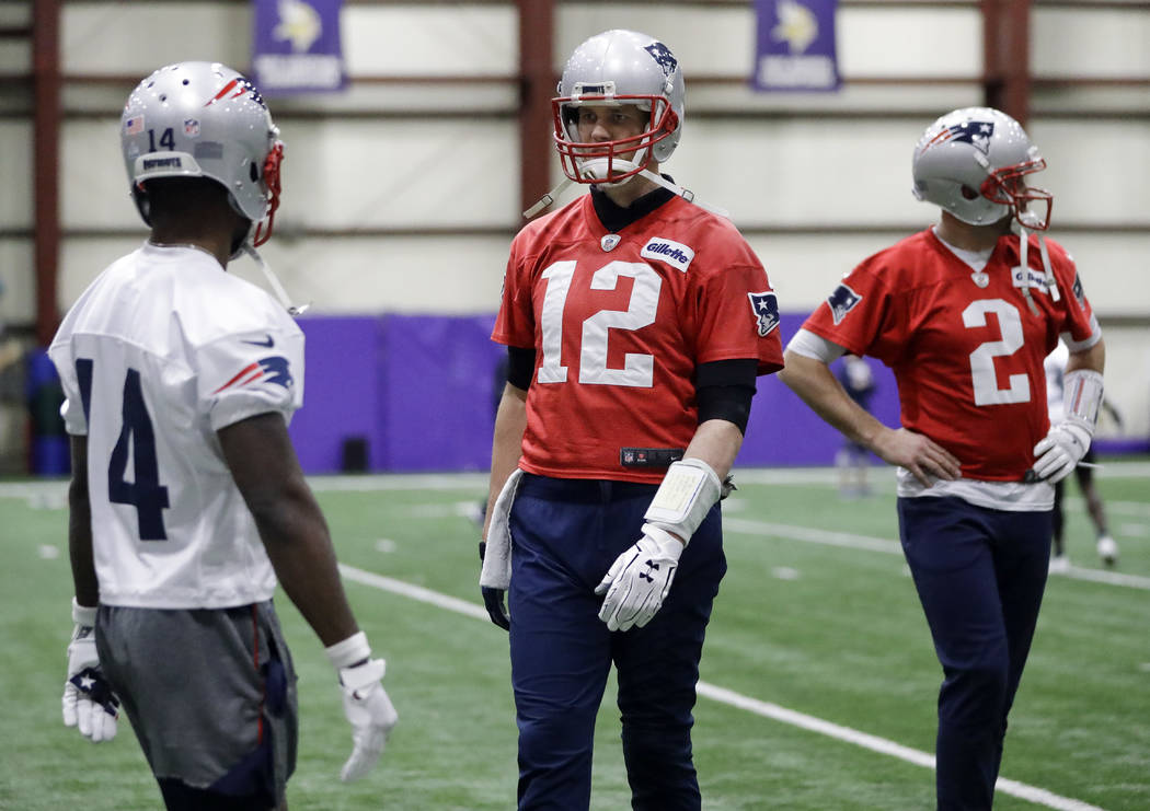 New England Patriots quarterback Tom Brady (12) talks with wide receiver Brandin Cooks (14) during practice Friday, Feb. 2, 2018, in Minneapolis. At right is quarterback Brian Hoyer (2). The Patri ...