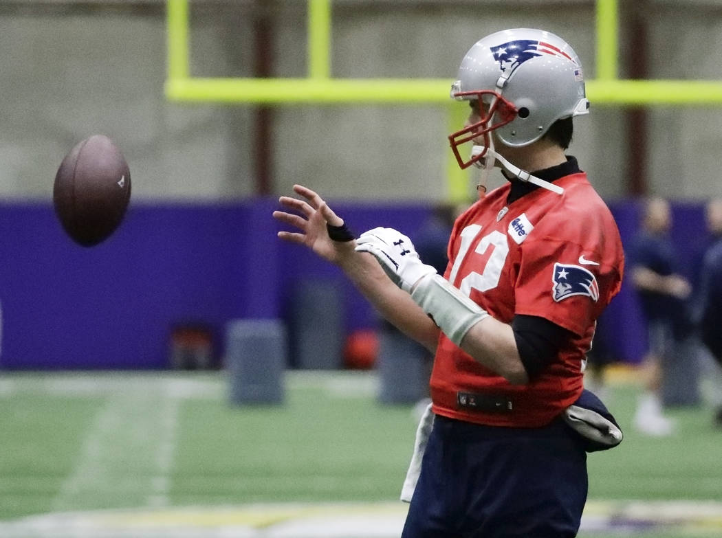 New England Patriots quarterback Tom Brady catches a ball during a practice Friday, Feb. 2, 2018, in Minneapolis. The Patriots are scheduled to face the Philadelphia Eagles in the NFL Super Bowl 5 ...