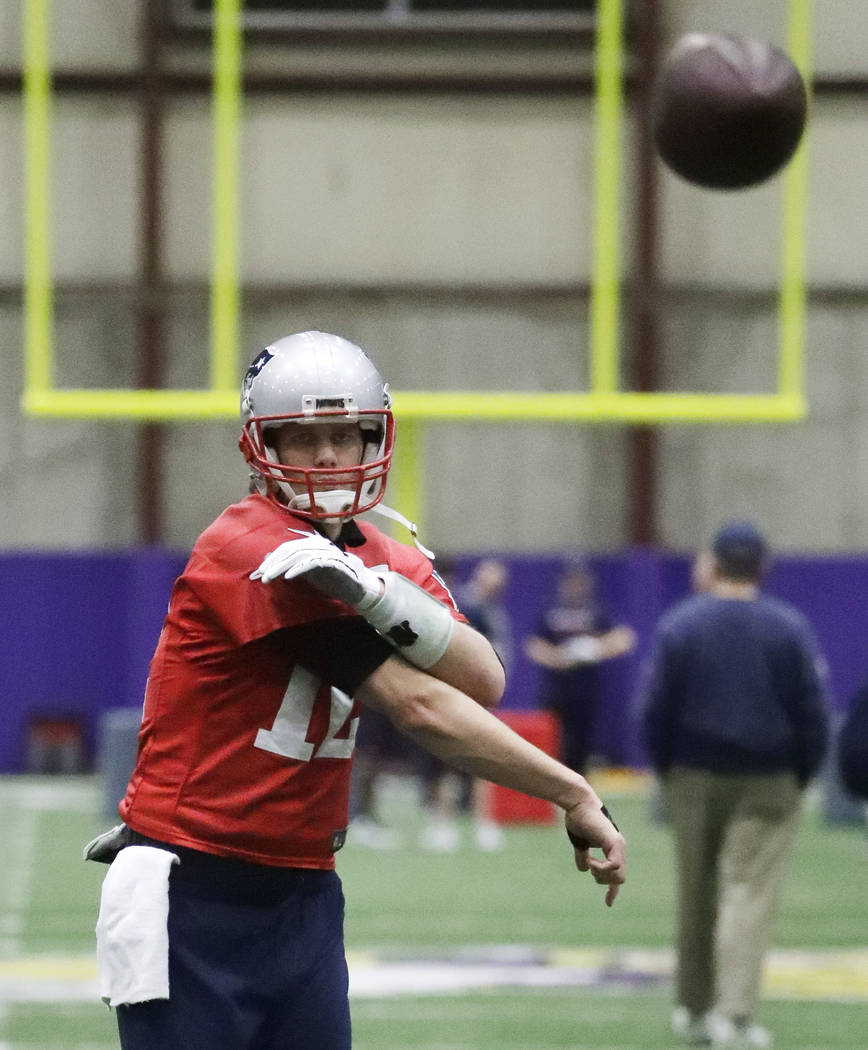 New England Patriots quarterback Tom Brady throws during a practice Friday, Feb. 2, 2018, in Minneapolis. The Patriots are scheduled to face the Philadelphia Eagles in the NFL Super Bowl 52 footba ...