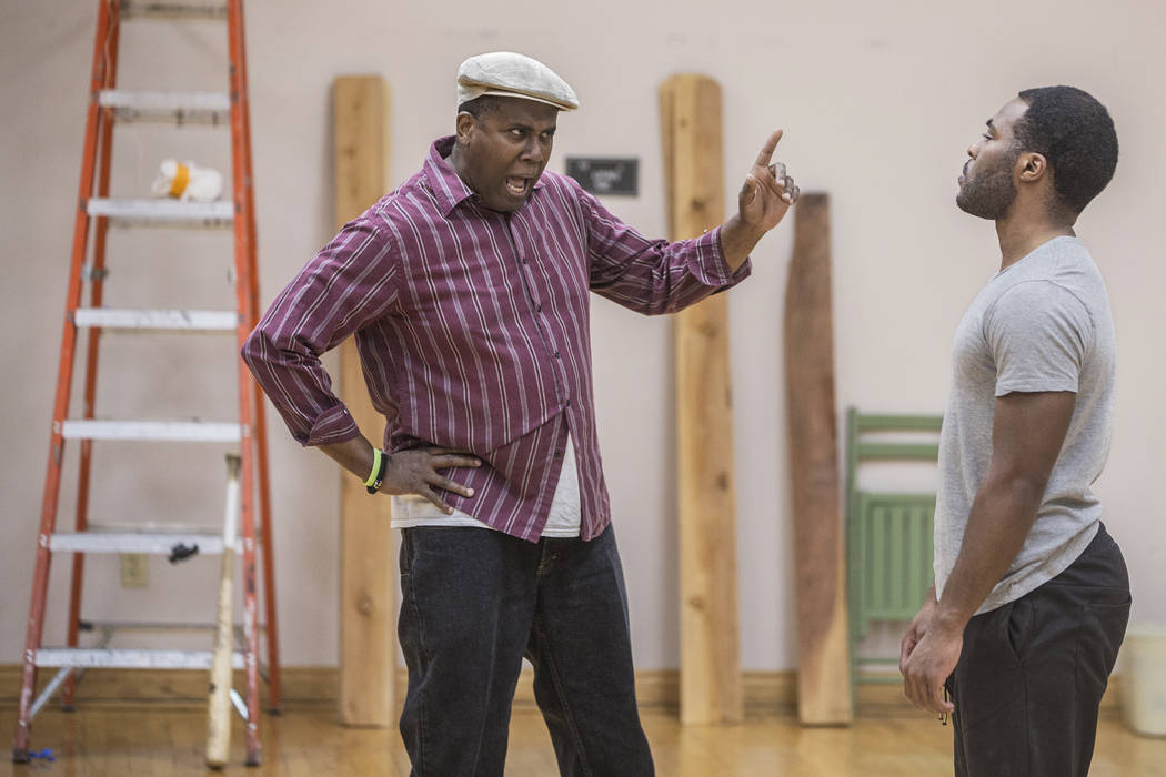 """James Austin Williams, left, and Tavius Strickland work through a scene during rehearsal for the Nevada Conservatory Theatre's """"Fences"""" at the Alta Ham Fine Arts Building on Mond ..."""
