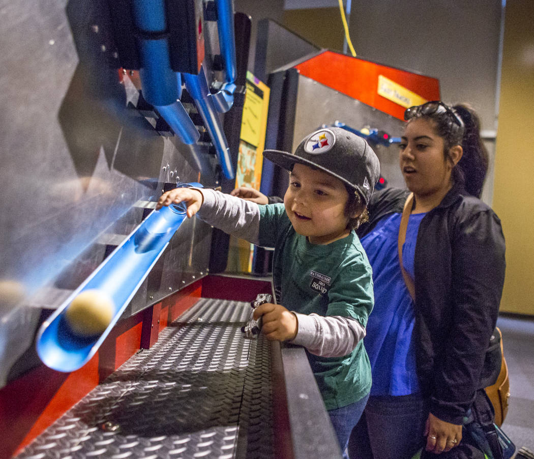 """Johnathan Winston, 2, plays with a ball and ramp with his mother, Jennifer Winston, at """"Design Zone,"""" a new exhibit in the Discovery Children's Museum in Las Vegas on Saturday, J ..."""