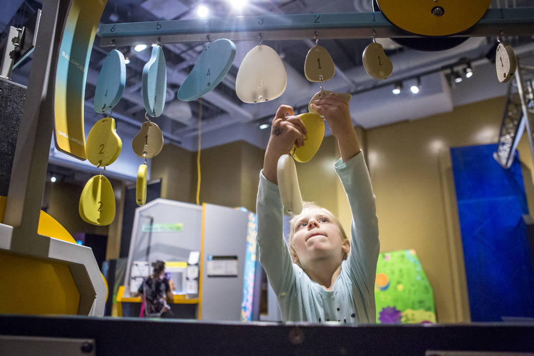 """Haley Anthony, 5, tries to balance a scale at """"Design Zone,"""" a new exhibit in the Discovery Children's Museum in Las Vegas on Saturday, Jan. 27, 2018.  Patrick Connolly Las Vegas ..."""