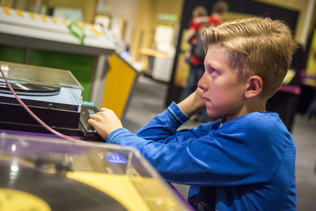 """Evan Anthony, 8, practices his skills as a DJ at """"Design Zone,"""" a new exhibit in the Discovery Children's Museum in Las Vegas on Saturday, Jan. 27, 2018.  Patrick Connolly Las Ve ..."""