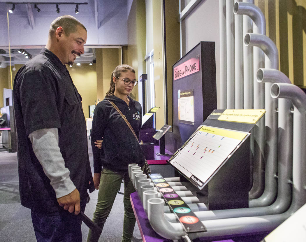 """Dave and Alexis Winston play with musical pipes at """"Design Zone,"""" a new exhibit in the Discovery Children's Museum in Las Vegas on Saturday, Jan. 27, 2018.  Patrick Connolly Las  ..."""