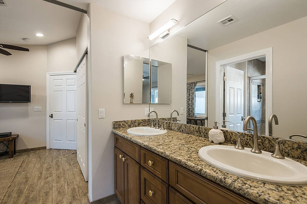 One of the baths at the property at 9590 Mule Deer Road. (Realty One Group)