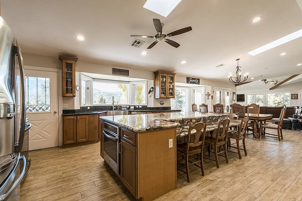 The kitchen flows into the family room. (Realty One Group)
