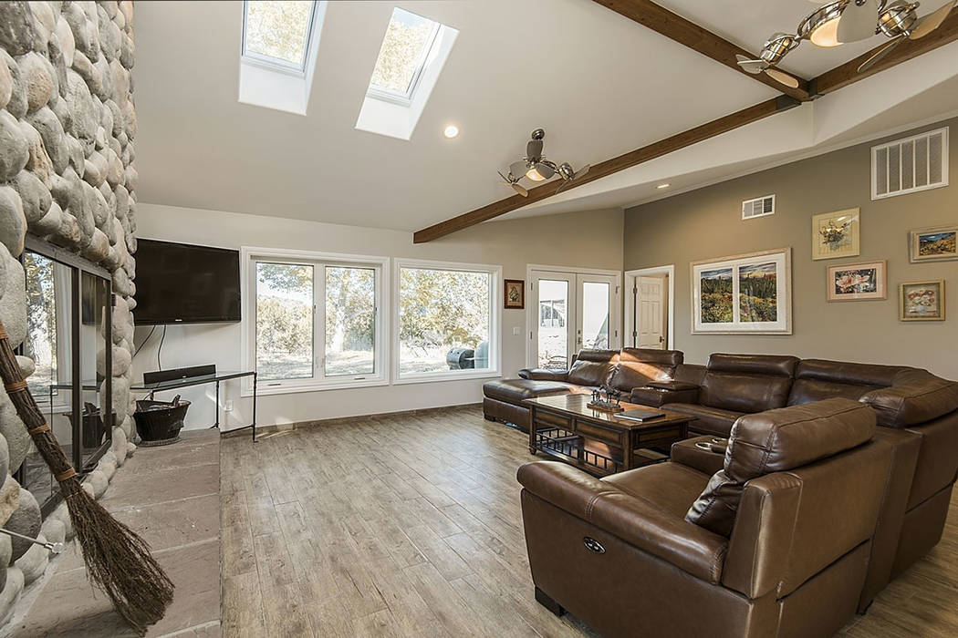 The family room features large windows. (Realty One Group)