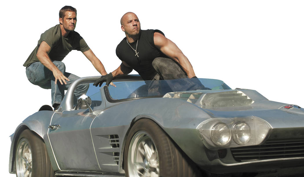 "(L to R) Brian O'Conner (PAUL WALKER) and Dom Toretto (VIN DIESEL) in a reunion of returning all-stars from every chapter of the explosive franchise built on speed--""Fast Five""."