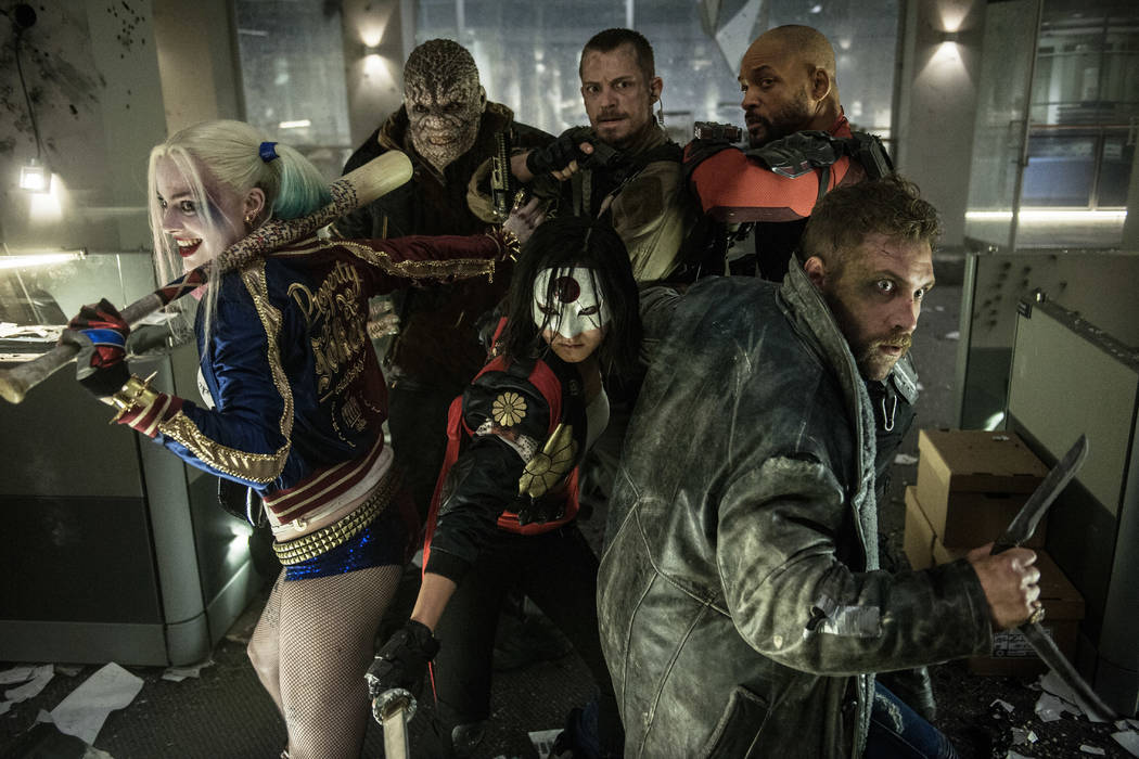 Margot Robbie as Harley Quinn, left, Adewale Akinnuoye-Agbaje as Killer Croc, Karen Fukuhara as Katana, Joel Kinnaman as Rick Flagg, Jai Courtney as Boomerang and Will Smith as Deadshot in the act ...