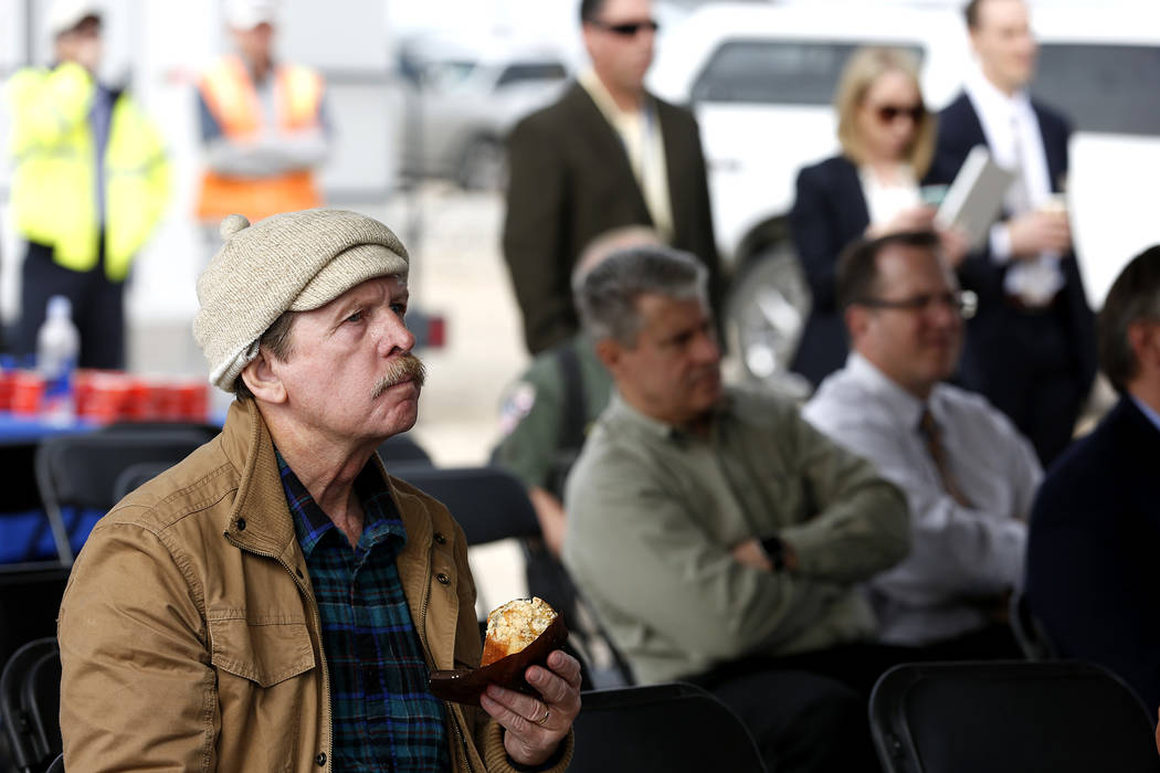 Bruce Duncan, who lives close to the work site, listens to the Nevada Department of Transportation's presser, which discussed the $65 million project aimed at improving a six mile stretch of U.S.  ...