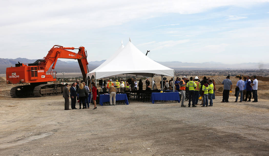 Attendees mingle after the Nevada Department of Transportation's presser, which discussed the $65 million project aimed at improving a six mile stretch of U.S. Highway 95 in Las Vegas, Thursday, F ...