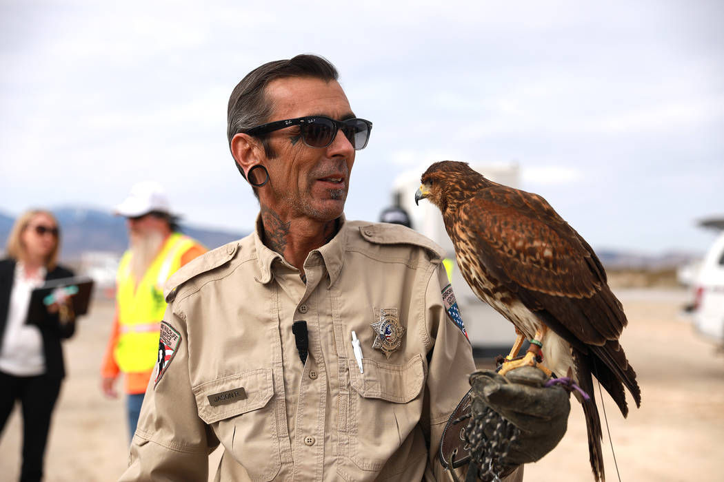 Jason Ripley, 49, a biologist with Airborne Wildlife Control Services, talks to the public about his hawk before the Nevada Department of Transportation's presser, which discussed the $65 million  ...