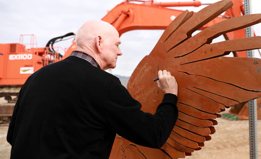 Clark County Commissioner Larry Brown signs a statue after the Nevada Department of Transportation's presser, which discussed the $65 million project aimed at improving a six mile stretch of U.S.  ...