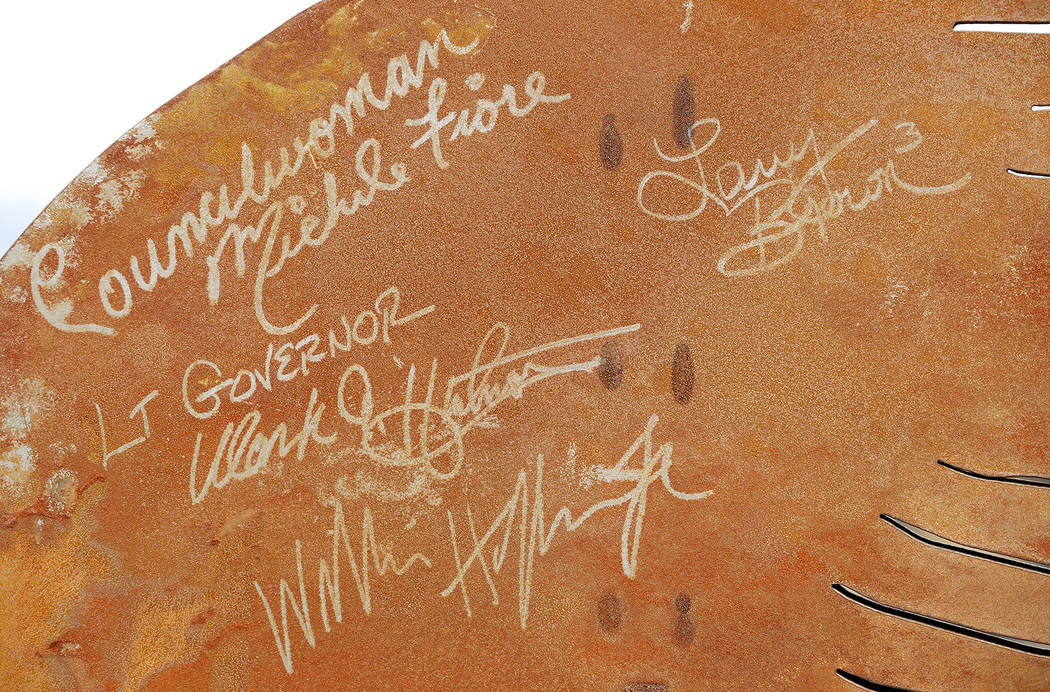 A portion of a statue is signed by officials after the Nevada Department of Transportation's presser, which discussed the $65 million project aimed at improving a six mile stretch of U.S. Highway  ...