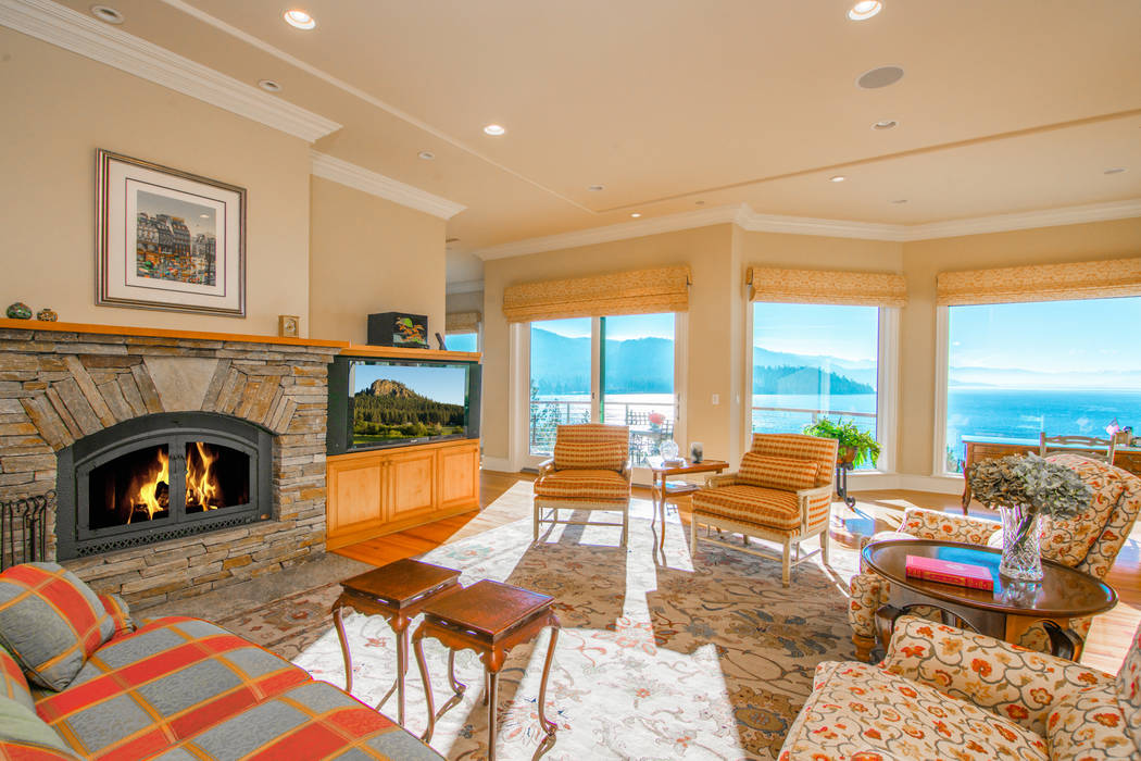 A fireplace is the center of the family room. (Oliver Luxury Real Estate)