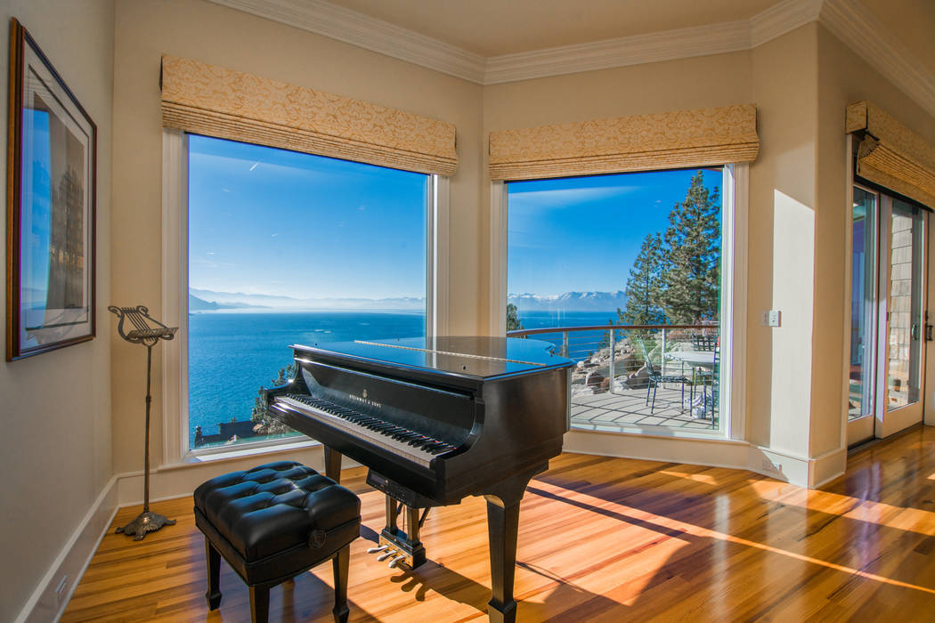 A first-floor entertainment spot offers views of the lake. (Oliver Luxury Real Estate)