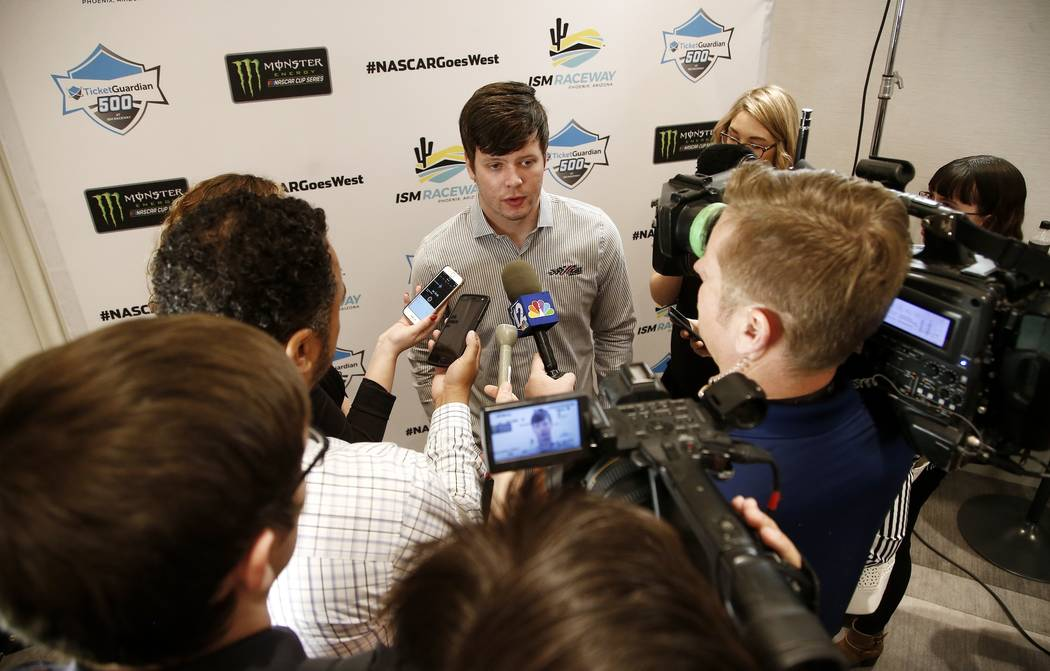 NASCAR Cup Series driver Erik Jones talks about the upcoming season with reporters at the NASCAR West Coast Media Day, Friday, Jan. 26, 2018, in Paradise Valley, Ariz. (AP Photo/Ross D. Franklin)