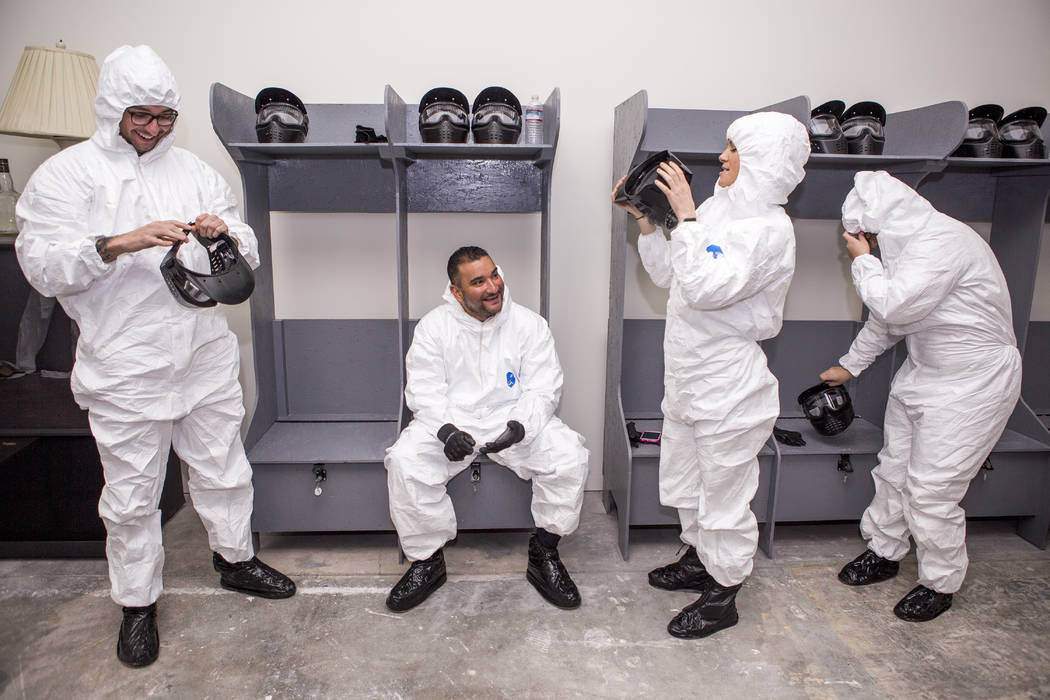 Las Vegas residents, from left, Cisco Mejia, Guadalupe Amezquita, Danielle Grojean and Amber Carroll get suited up for their session at the Wreck Room in Las Vegas on Wednesday, Jan. 31, 2018. (Pa ...