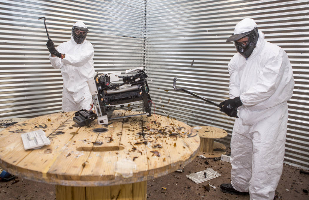 Las Vegas residents Cisco Mejia, left, and Brandon Fleisher take turns smashing a printer at the Wreck Room in Las Vegas on Wednesday, Jan. 31, 2018. (Patrick Connolly/Las Vegas Review-Journal) @P ...