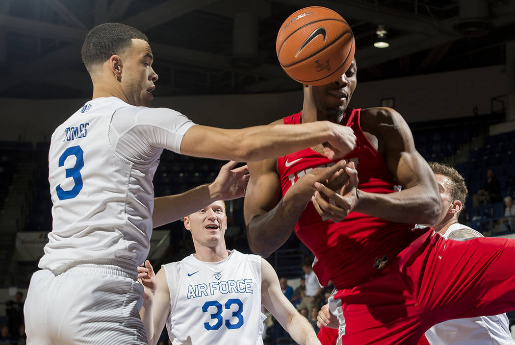 UNLV forward Shakur Juiston (10) is hit by a rebounded ball next to Air Force's Sid Tomes during an NCAA college basketball game at Air Force Academy, Colo., Wednesday, Jan. 10, 2018. (Dougal Brow ...