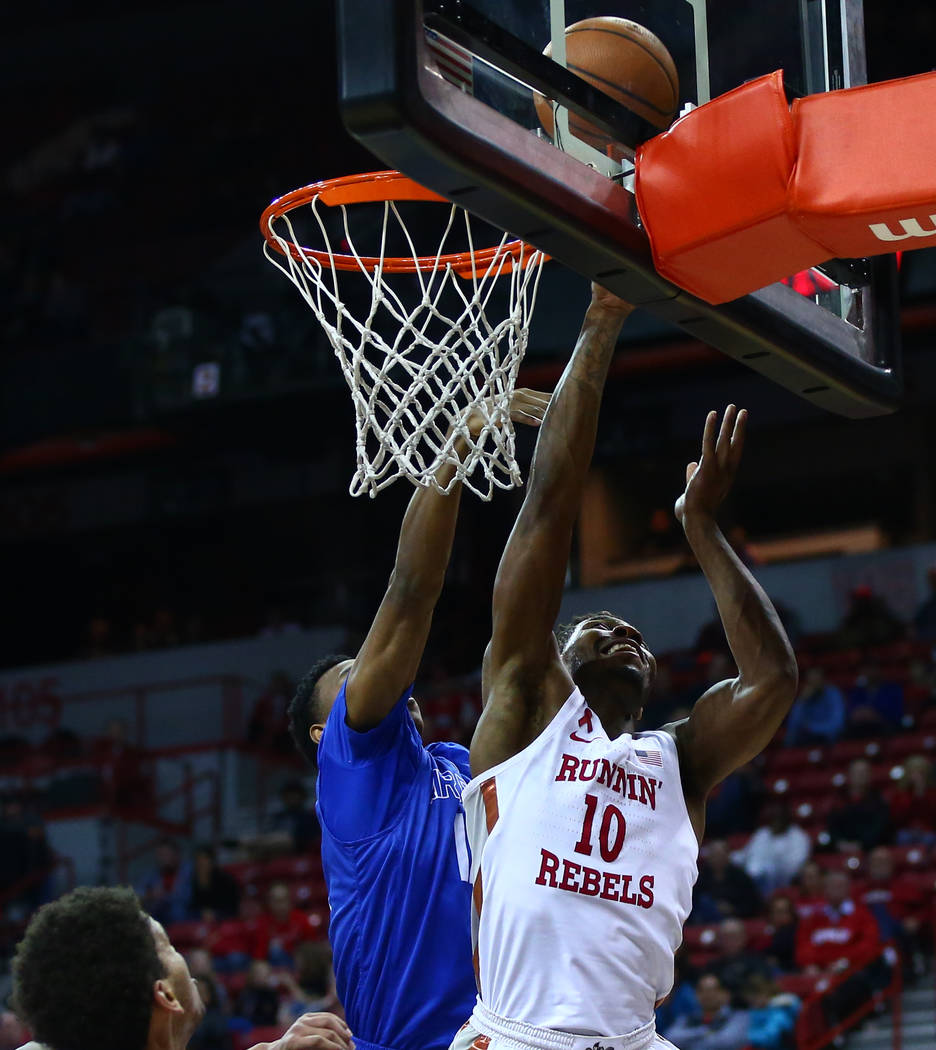 UNLV Rebels forward Shakur Juiston (10) goes to the basket past Air Force Falcons forward Lavelle Scottie (12) during a basketball game at the Thomas & Mack Arena in Las Vegas on Wednesday, Fe ...