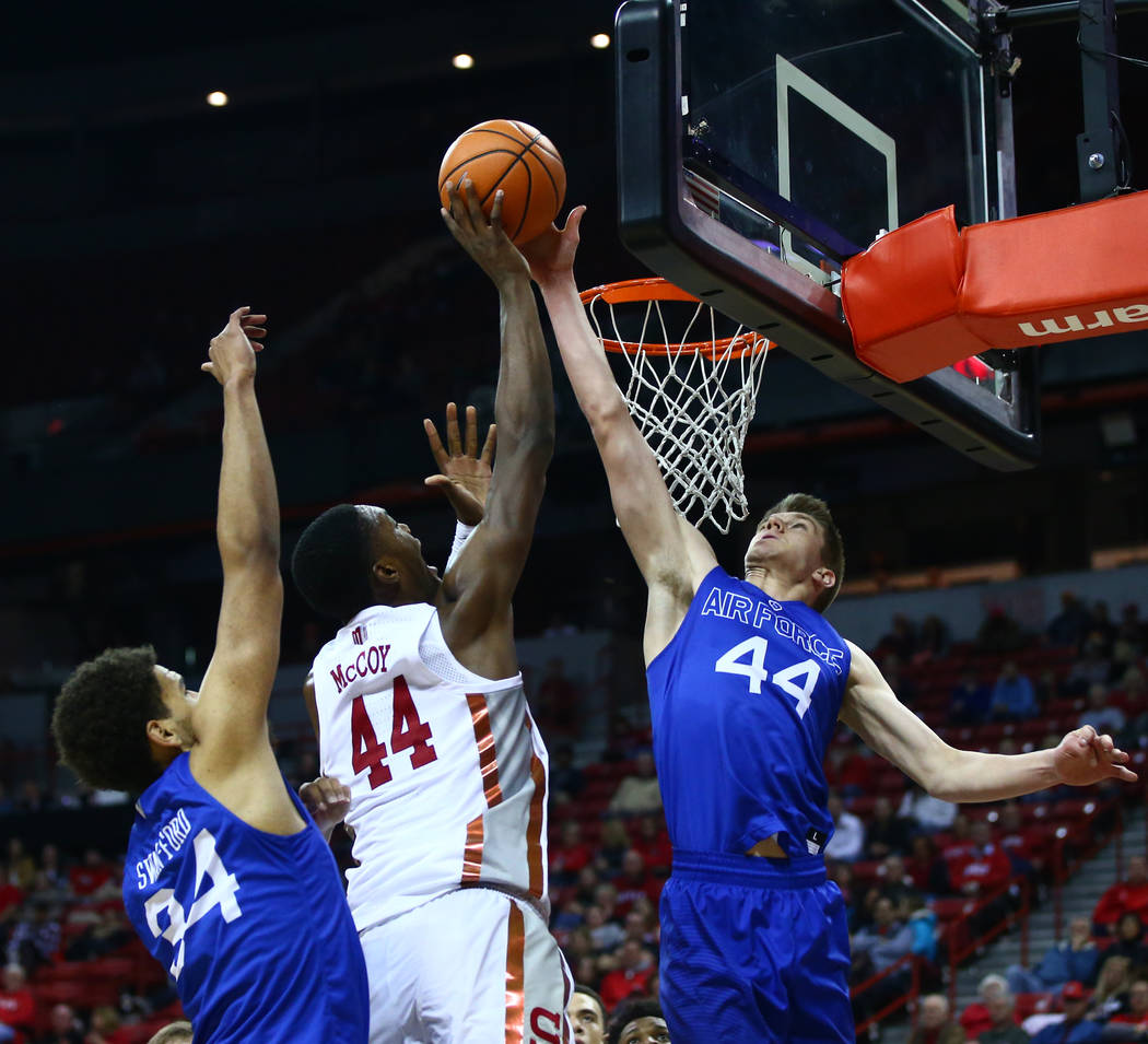 Air Force Falcons guard Keaton Van Soelen (44), right, blocks a shot from UNLV Rebels forward Brandon McCoy (44) during a basketball game at the Thomas & Mack Arena in Las Vegas on Wednesday,  ...