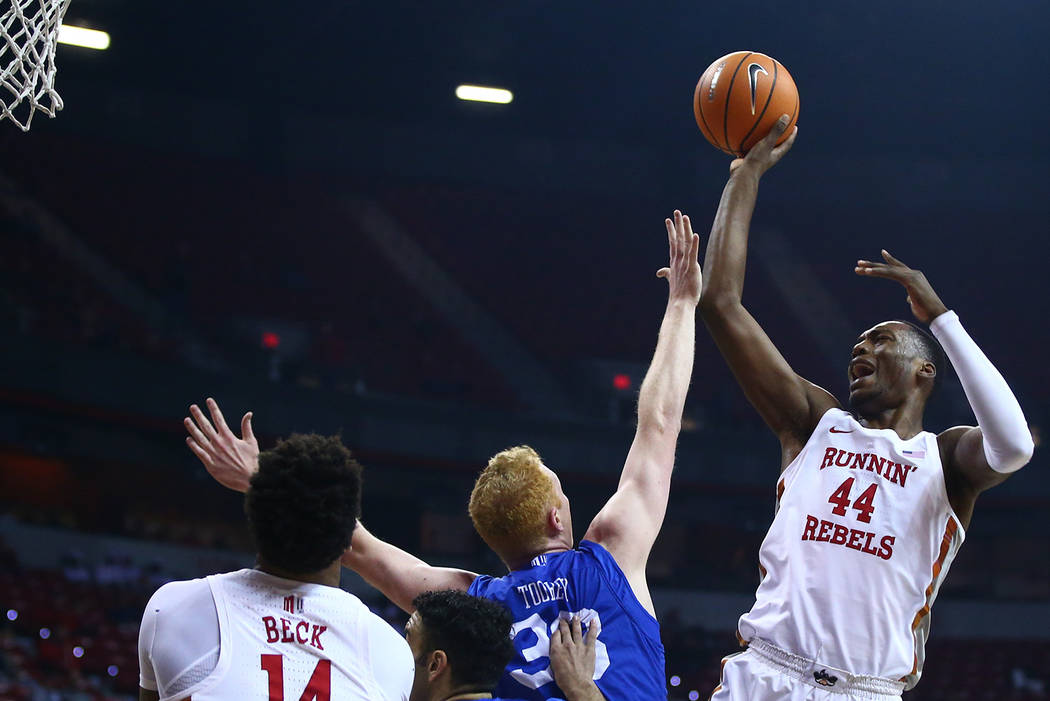 UNLV Rebels forward Brandon McCoy (44) shoots over Air Force Falcons center Frank Toohey (33) and guard Caleb Morris (0) during a basketball game at the Thomas & Mack Arena in Las Vegas on Wed ...