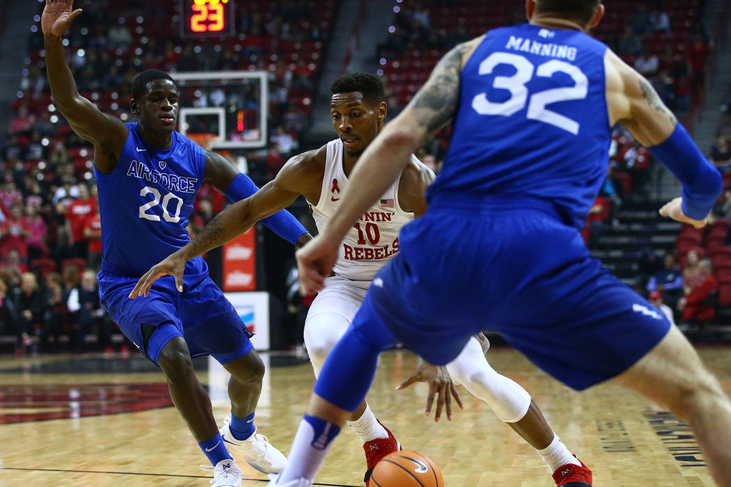 UNLV Rebels forward Shakur Juiston (10) drives to the basket between Air Force Falcons guard Trevor Lyons (20) and forward Ryan Manning (32) during a basketball game at the Thomas & Mack Arena ...
