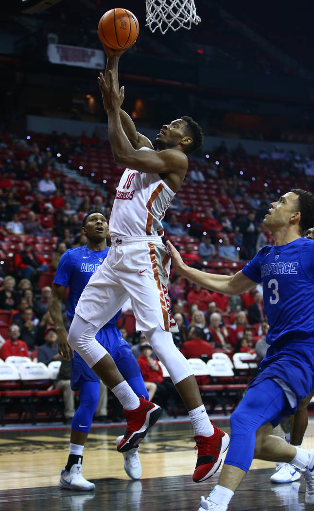 UNLV Rebels forward Shakur Juiston (10) goes up for a shot past Air Force Falcons guard Sid Tomes (3) during a basketball game at the Thomas & Mack Arena in Las Vegas on Wednesday, Feb. 14, 20 ...