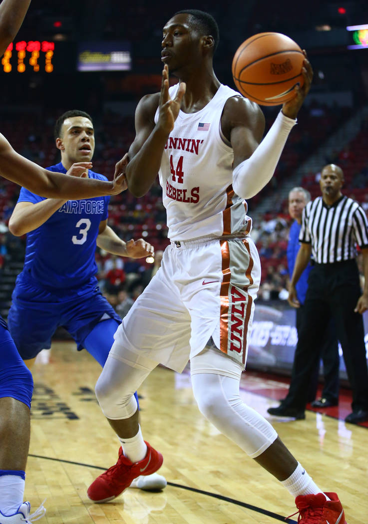 UNLV Rebels forward Brandon McCoy (44) takes the ball past Air Force Falcons guard Sid Tomes (3) during a basketball game at the Thomas & Mack Arena in Las Vegas on Wednesday, Feb. 14, 2018. C ...