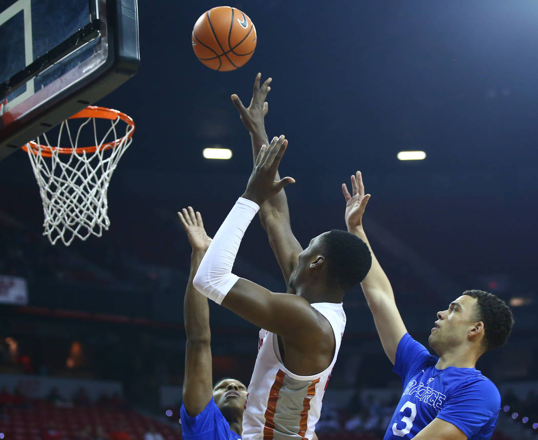 UNLV Rebels forward Brandon McCoy (44) sends up a shot between Air Force Falcons forward Lavelle Scottie, left, and Air Force Falcons guard Sid Tomes (3) during a basketball game at the Thomas &am ...