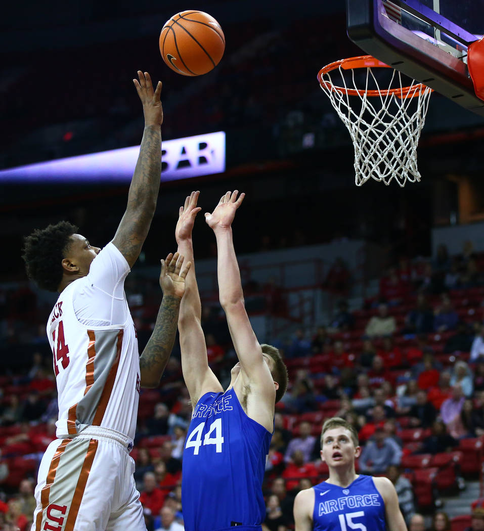 UNLV Rebels forward Brandon McCoy (44), left, shoots over Air Force Falcons guard Keaton Van Soelen (44) during a basketball game at the Thomas & Mack Arena in Las Vegas on Wednesday, Feb. 14, ...