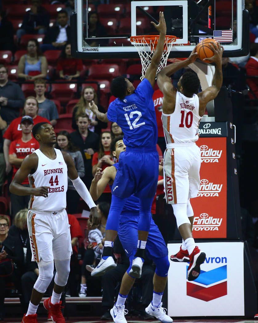 UNLV Rebels forward Shakur Juiston (10) gets a rebound over Air Force Falcons forward Lavelle Scottie (12) during a basketball game at the Thomas & Mack Arena in Las Vegas on Wednesday, Feb. 1 ...