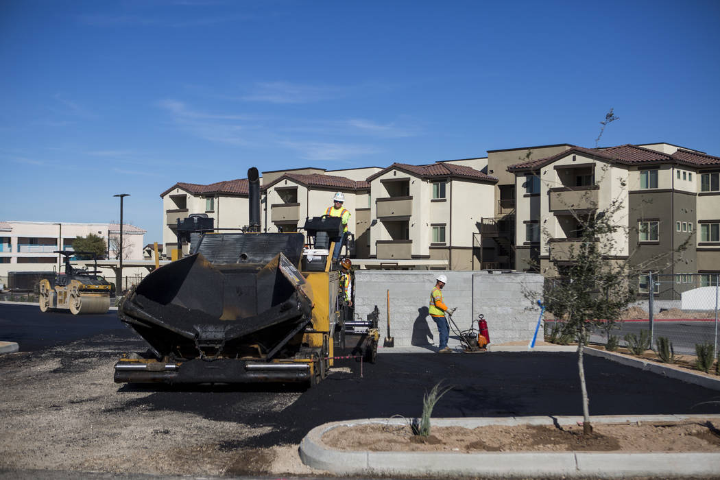 Construction workers finish paving a parking lot at the Boulder Pines Family Apartments on Boulder Highway in Las Vegas on Friday, Feb. 2, 2018.  Patrick Connolly Las Vegas Review-Journal @PConnPie