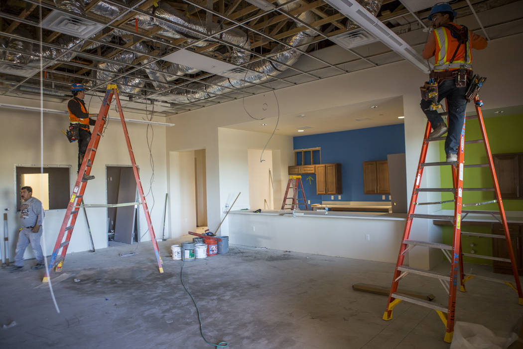 Construction workers run wiring in the space that will become the leasing office and recreation building at Boulder Pines Family Apartments on Boulder Highway in Las Vegas on Friday, Feb. 2, 2018. ...