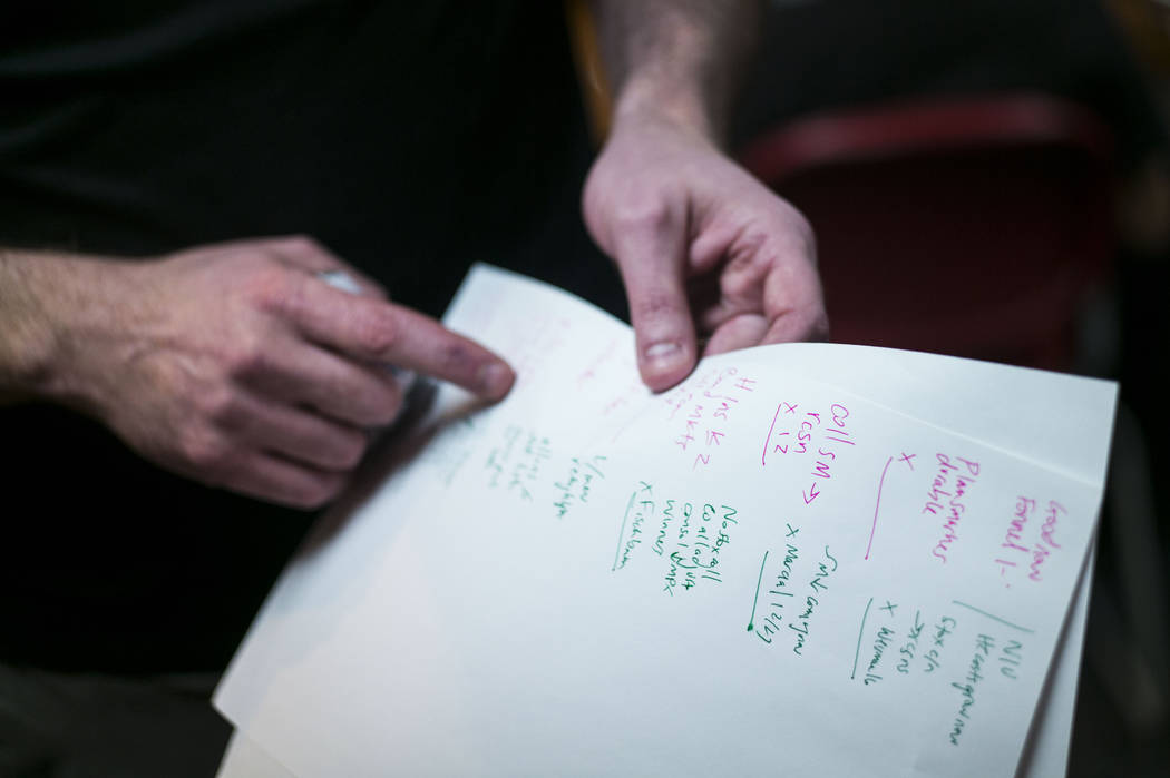 Jacob Thompson, director of the UNLV Debate Team, points to his notes from practice during a group meeting at UNLV in Las Vegas on Wednesday, Jan. 31, 2018. The team is ranked as one of the top de ...