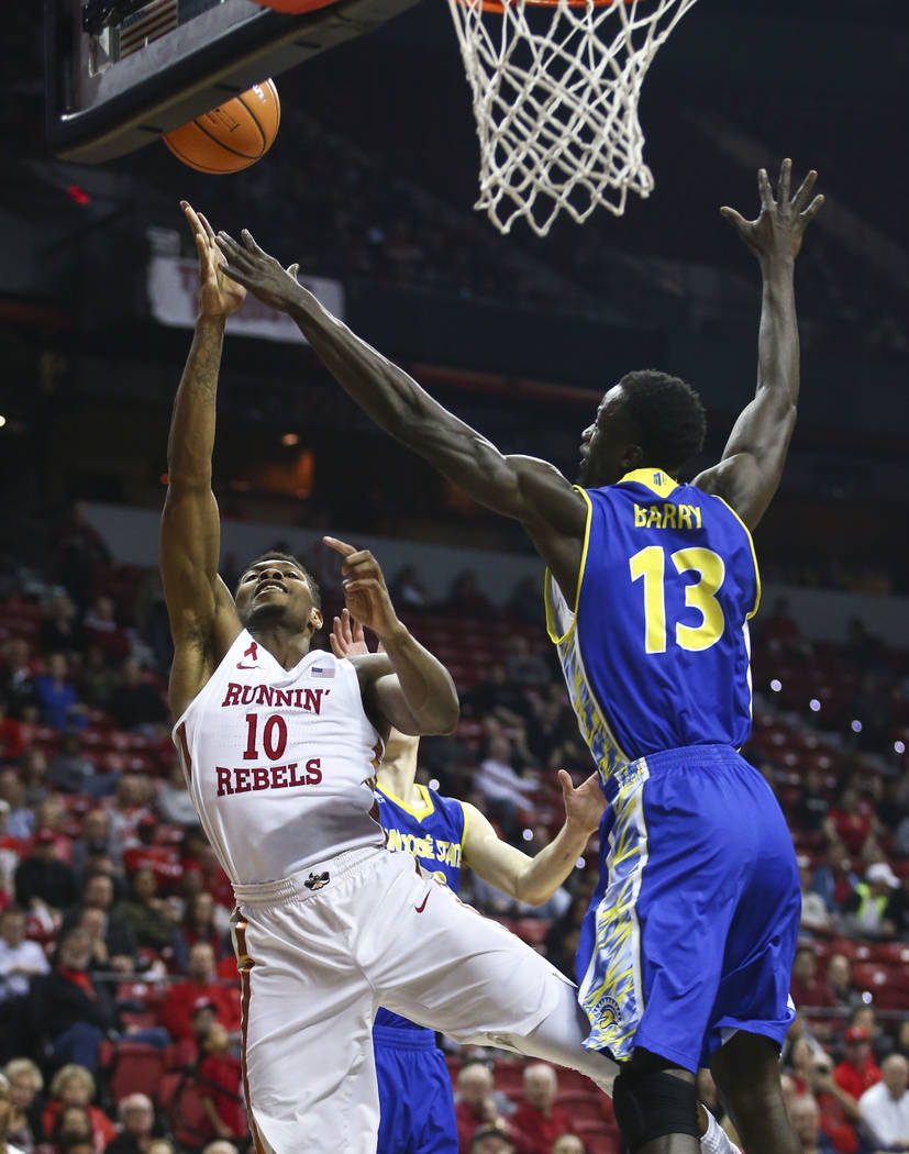 UNLV Rebels forward Shakur Juiston (10) goes up for a shot as San Jose State Spartans center Oumar Barry (13) defends during a basketball game at the Thomas & Mack Center in Las Vegas on Wedne ...