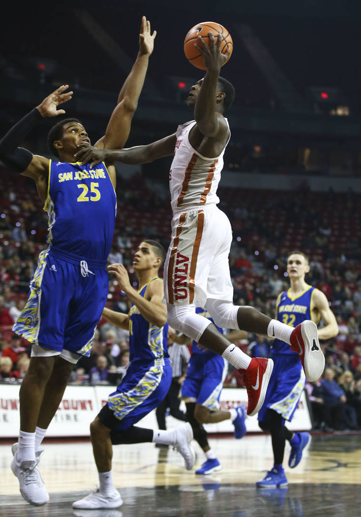 UNLV Rebels guard Amauri Hardy (3)  goes to the basket against San Jose State Spartans guard Jaycee Hillsman (25) during a basketball game at the Thomas & Mack Center in Las Vegas on Wednesday ...
