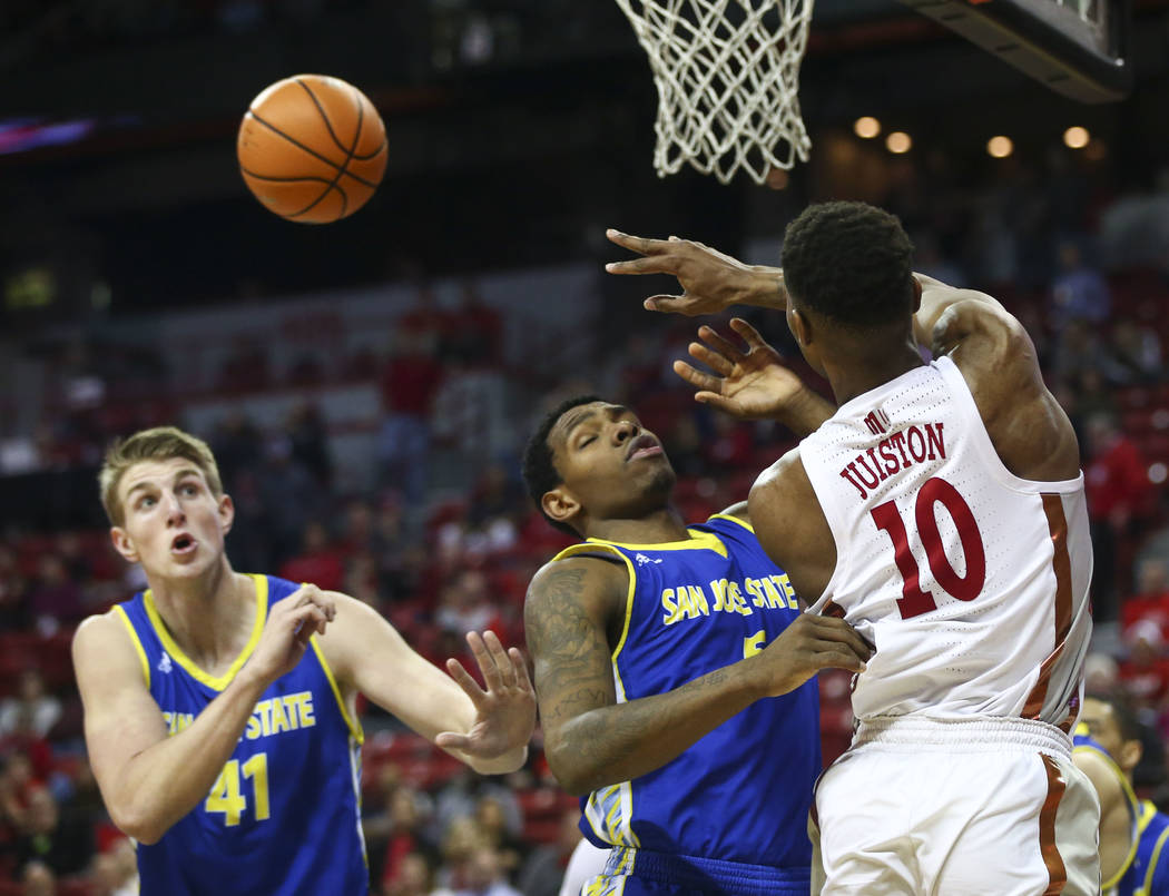 UNLV Rebels forward Shakur Juiston (10) sends a pass over San Jose State Spartans forward Keith Fisher III (5) and center Ashtin Chastain (41) during a basketball game at the Thomas & Mack Cen ...